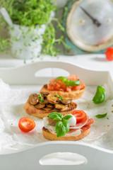 Homemade and fresh various bruschetta with fresh ingredients
