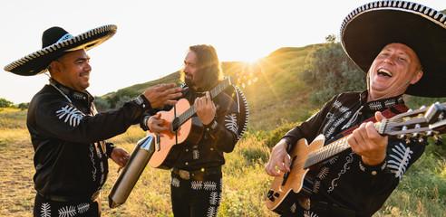 Mexican musicians mariachi outdoor.
