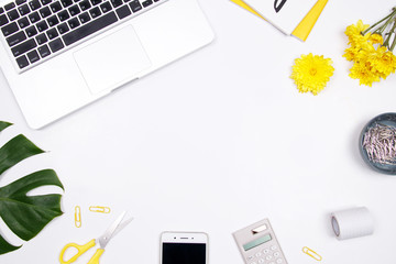 Woman workspace with laptop, handwritten quote notebook, yellow flower and smartphone on white background. Flat lay, top view. stylish female blogger concept. spring summer background.
