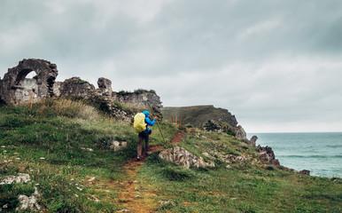 Traveler on the sea coast, North Spain