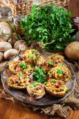 Baked potatoes stuffed with bacon, mushrooms and cheese