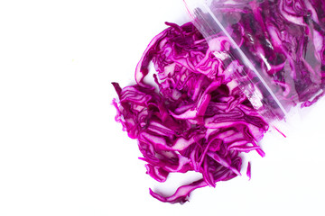 Plastic bag with frozen red cabbage slices  isolated on white. Vegetable preservation