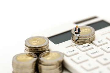 Miniature people : Businessman and friend with  calculator and stack of coins,business  finance concept.