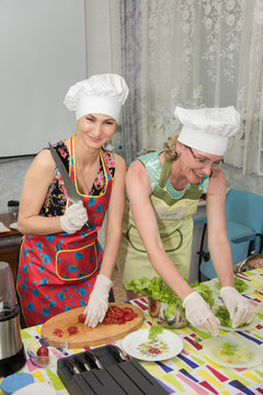 A females chefs preparing a salad in the master class
