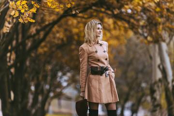 Mature woman walks in the autumn park