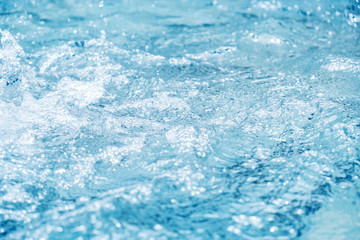 Water splash in swimming pool summer background