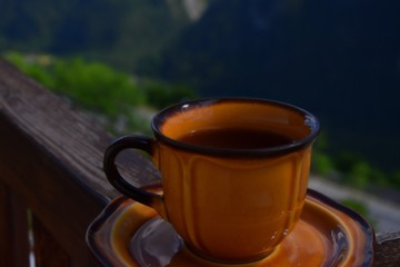 Tea cup on the mountains background