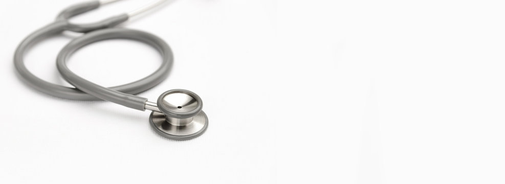 Gray stethoscope medical equipment on white canvas with copy space. instruments device for doctor. medicine concept