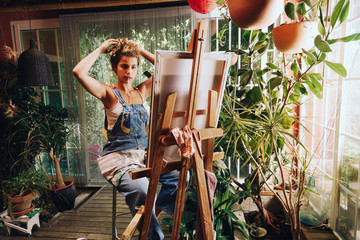 Woman painter painting in her painting studio.