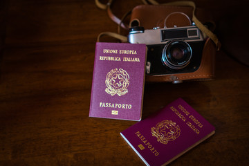vintage camera passport over the wood