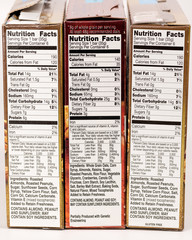 Facts on the side of three boxes listing nutrition information such as calories
