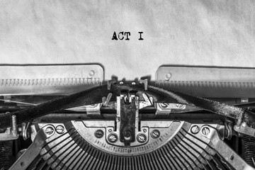 ACT I, typed text on a vintage typewriter, screenplay title heading. On old paper with ink. writer's idea
