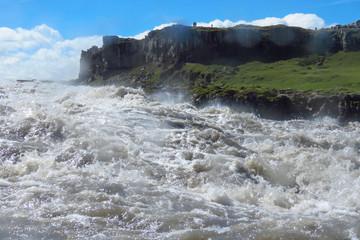 Wild water splashing, even on camera lens, at Dettifoss waterfall, Iceland