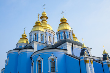 Blue Orthodox Church with golden rooftops