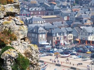 Picturesque landscape of Etretat commune, view of the ancient city from the cliffs. Etretat, Normandy, France. Coast of the Pays de Caux area in sunny summer day, tourists and holidaymakers