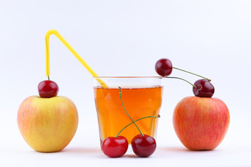 Fresh juice with apples and cherries, fresh apple juice on white background, healthy lifestyle, vegetarian drink, red berries with other fruits