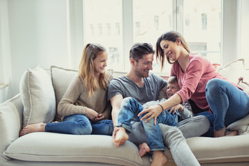modern happy familie at home on couch