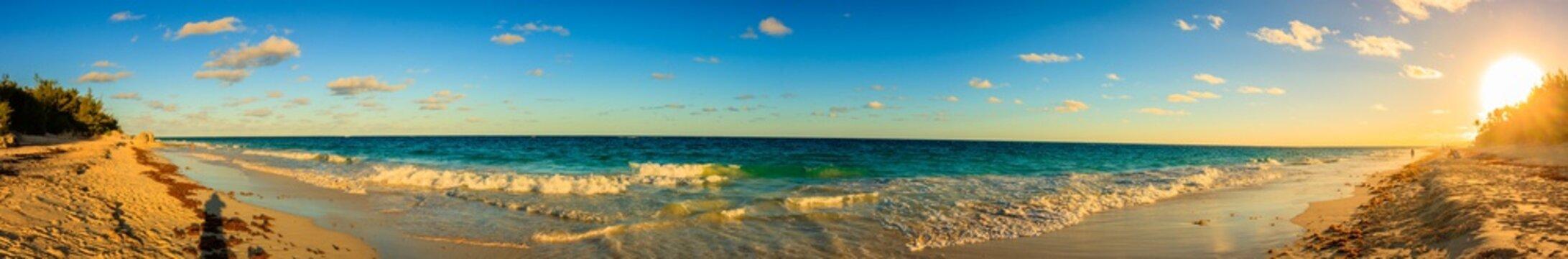 Panoramic photo of beautiful sunset over the Horseshoe Bay beach in Bermuda.
