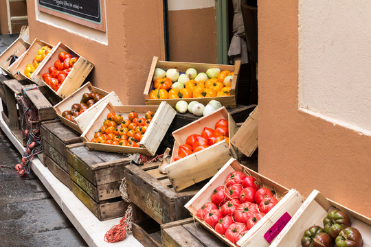 Vegetables and fruits in wooden crates at market