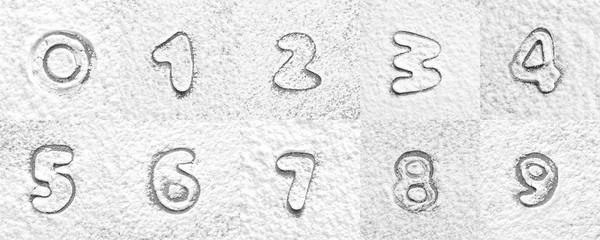 Set with silhouettes of numbers on scattered flour