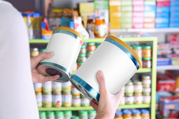 Woman choosing baby milk formula in store
