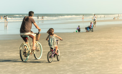 Poster Bicycle Father and Daughter Biking on Beach, Retro Look