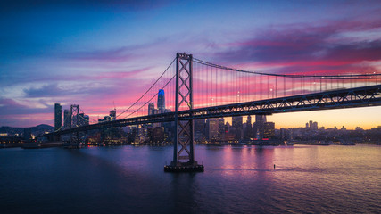 Fototapete - Aerial Cityscape view of San Francisco and the Bay Bridge with Colorful Sunset