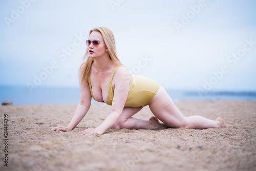 6b006161002 Beautiful plus size model wearing fashion swimsuit and sunglasses ...