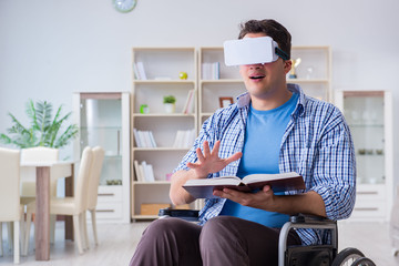 Disabled student studying with virtual reality glasses