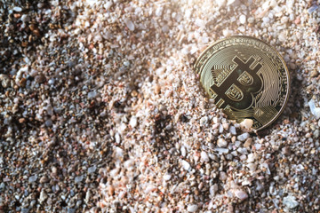 crypto currency coin symbol sunk in sand sea texture floor business financial ideas concept