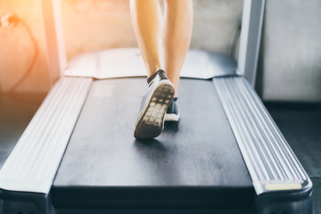 people workout with treadmill in fitness club health and body concept