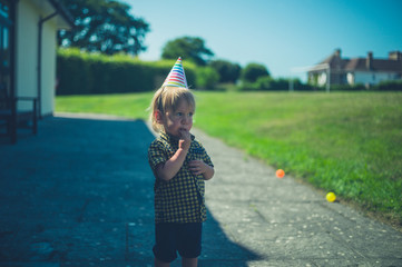 Little toddler with party hat