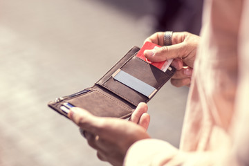 Close up Holding brown leather wallet in the hand