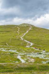 People heading to a mountain peak
