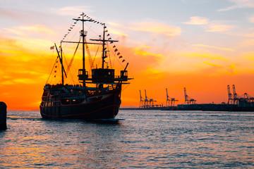 Cruise ship and dramatic sunset at Osaka port in Japan