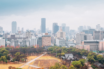 Modern buildings and urban landscape at autumn from Osaka Castle in Japan