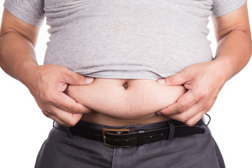 Close-up of man holding unhealthy big belly visceral subcutaneous fats