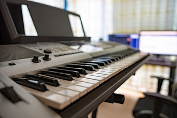 Electric piano in front of a working station