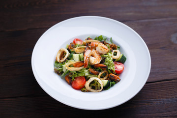 Healthy food, property nutrition,mediterranean diet.  Appetizing fresh vegetable and prawns salad. Delicious seafood