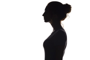 silhouette profile of young woman on a white isolated background