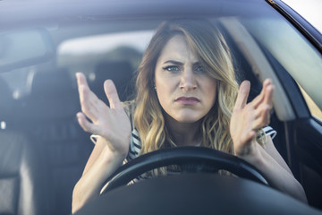 Angry woman driving a car.