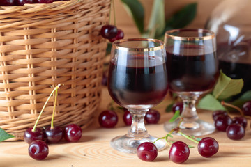 Cherry wine or liquor and ripe juicy cherries.