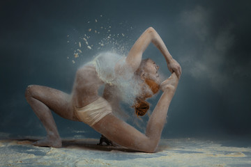 Printed roller blinds People Dancing in flour concept. Redhead beauty gymnast female girl adult woman dancer in dust / fog. Girl wearing white top and shorts making dance element in flour cloud on isolated grey black background