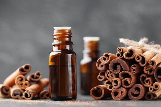 Cinnamon essential oil for spa, aromatherapy, wellness, medical background.