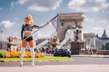 Sexy Grid Girl Hostess Woman Holding Starting Car Racing Flag in Budapest