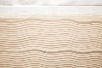 Summer beach background - sand and wooden plank