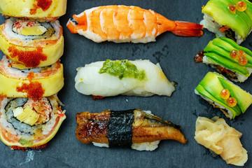 luxury japanese sushi set on black slate stone