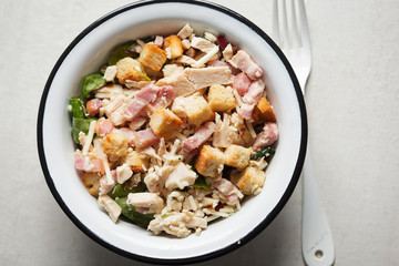 Chicken caesar salad with croutons and parmesan