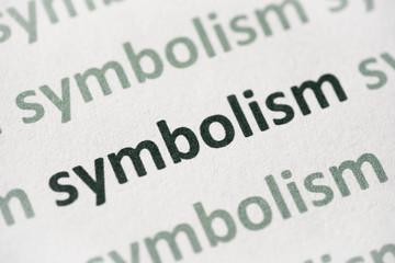 word symbolism printed on paper macro