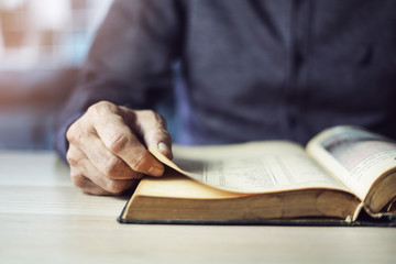 Man reading book close up view